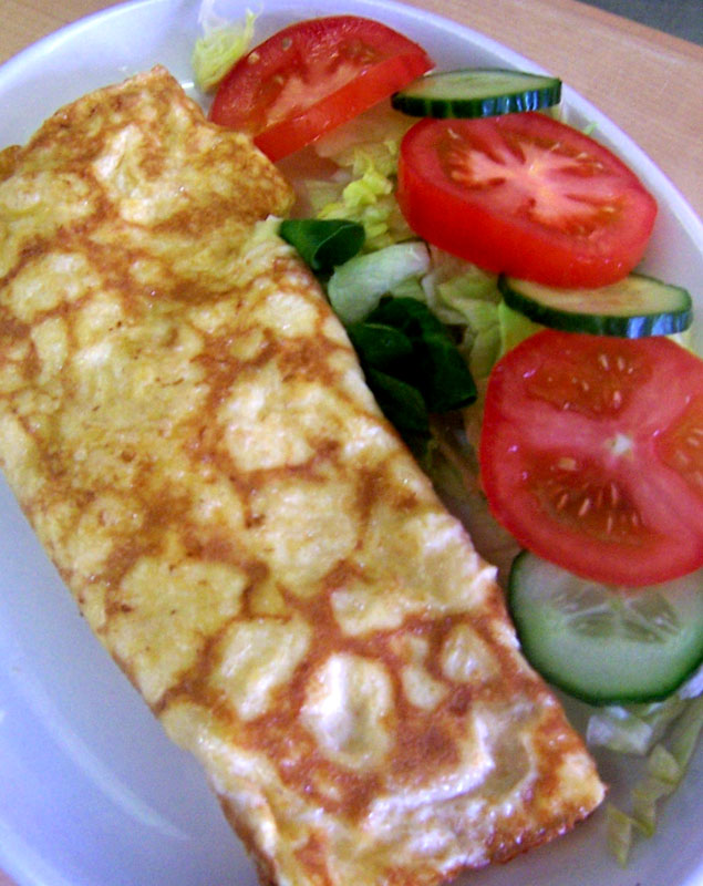 Lunch food - Omelettes served with a side salad.
